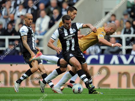 Stephen Taylor of Newcastle United and Pajtim Kasami of Fulham United Kingdom Newcastle