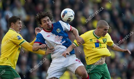 Grant Holt and Steve Morison of Norwich City Compete For the Ball with Gael Givet of Blackburn Rovers United Kingdom Norwich