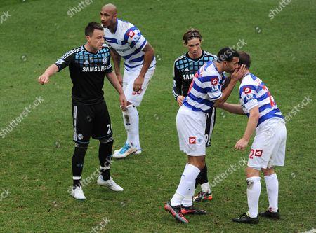 Anton Ferdinand of Qpr Whispers in the Ear of Heidar Helguson As John Terry and Fernando Torres of Chelsea Look On United Kingdom London