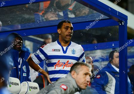 Stock Image of Anton Ferdinand of Queens Park Rangers Looks On From the Dugout with Shaun Wright-phillips United Kingdom London