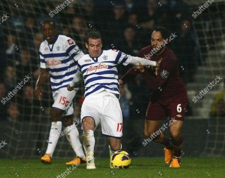 Queens Park Rangers' Ryan Nelsen Battles with Manchester City's Joleon Lescott United Kingdom London