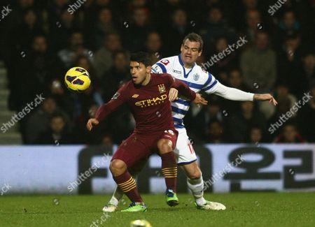 Manchester City's Sergio Aguero Battles with Queens Park Rangers' Ryan Nelsen United Kingdom London