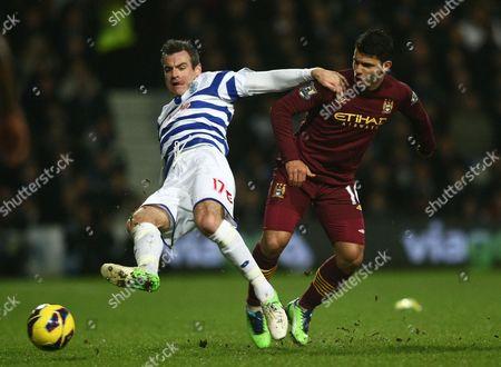 Queens Park Rangers' Ryan Nelsen Battles with Manchester City's Sergio Aguero United Kingdom London
