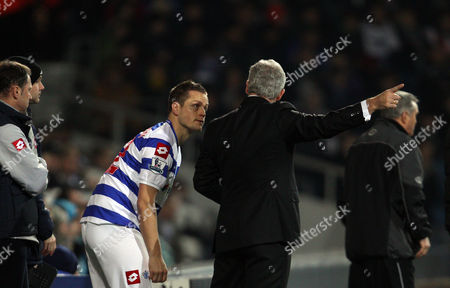 Mark Hughes Manager of Queens Park Rangers Speaks with Heidar Helguson of Queens Park Rangers United Kingdom London