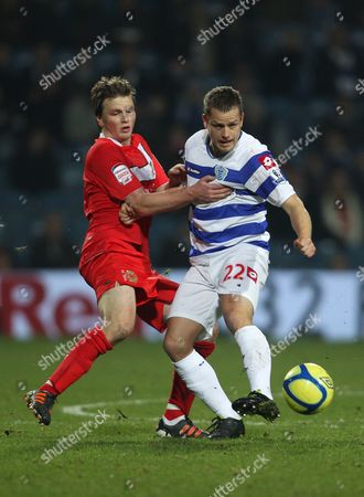 Heidar Helguson of Queens Park Rangers in Action with Stephen Gleeson of Mk Dons United Kingdom London