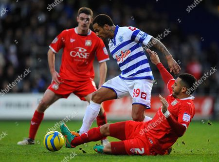 Dj Campbell of Qpr is Tackled by Jon Otsemobor of Milton Keynes Dons United Kingdom London