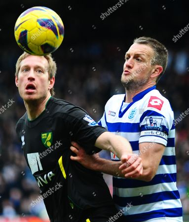 Clint Hill of Qpr Battles with Luciano Becchio of Norwich City United Kingdom London