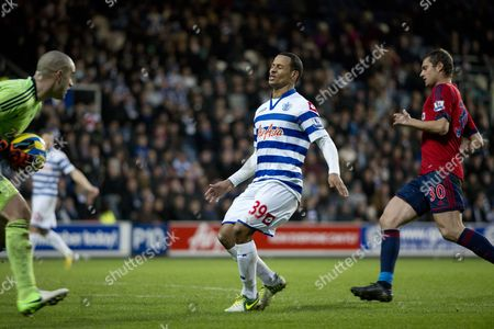 Dj Campbell of Queens Park Rangers and Boaz Myhill Goalkeeper of West Bromwich Albion United Kingdom London