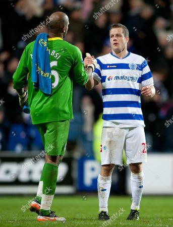 Heidar Helguson of Qpr Shakes Hands with Wigan Athletic Goalkeeper Ali Al-habsi United Kingdom London