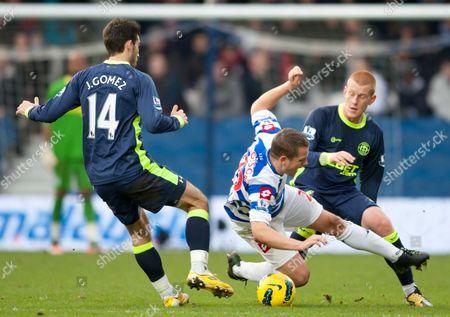 Heidar Helguson of Qpr Takes On Jordi Gomez and Ben Watson of Wigan Athletic United Kingdom London