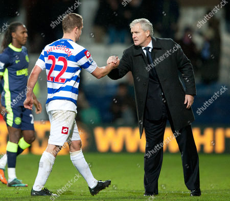 Qpr Manager Mark Hughes Shakes Hands with Heidar Helguson United Kingdom London