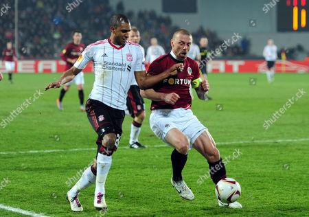 David Ngog of Liverpool and Tomas Repka of Sparta Praha Czech Republic Prague