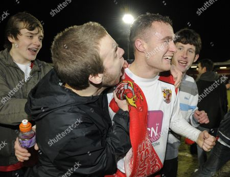 Stock Image of Peter Winn of Stevenage Walks Off the Field Surrounded by Fans After His Sides Historic Win United Kingdom Stevenage
