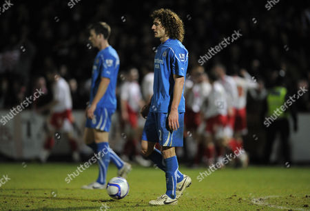 Fabricio Coloccini and Mike Williamson of Newcastle United Look Dejected As Stevenage Players Celebrate the Third Goal Scored by Peter Winn United Kingdom Stevenage