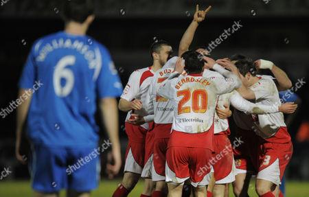 Stevenage Players Celebrate the Goal of Stacy Long 1-0 United Kingdom Stevenage