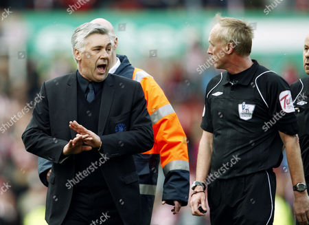 Chelsea Manager Carlo Ancelotti Argues with Referee Mr Peter Walton at the End of the Game United Kingdom Stoke