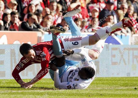 Glenn Whelan of Stoke City Crashes Over Victor Obinna of West Ham United United Kingdom Stoke