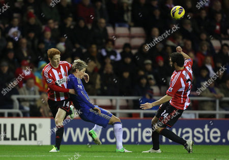 Fernando Torres of Chelsea in Between Jack Colback of Sunderland and Carlos Cuellar United Kingdom Sunderland