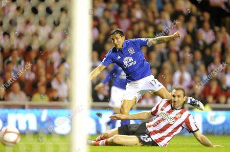 Tim Cahill of Everton Shoots at Goal As Sotirios Kyrgiakos of Sunderland Tackles United Kingdom Sunderland