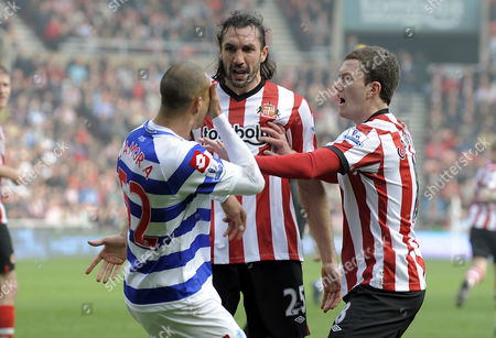 Stock Picture of Bobby Zamora of Qpr and Sotirios Kyrgiakos of Sunderland Clash Their Heads Together As Craig Gardner of Sunderland Pulls Them Apart United Kingdom Sunderland