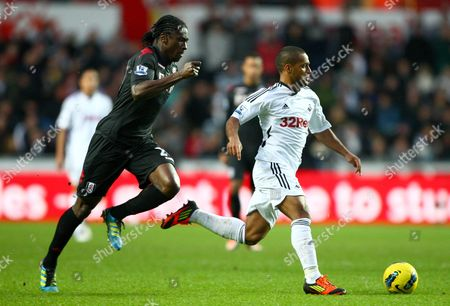 Dickson Etuhu of Fulham and Swansea City Midfielder Wayne Routledge in Action United Kingdom Swansea