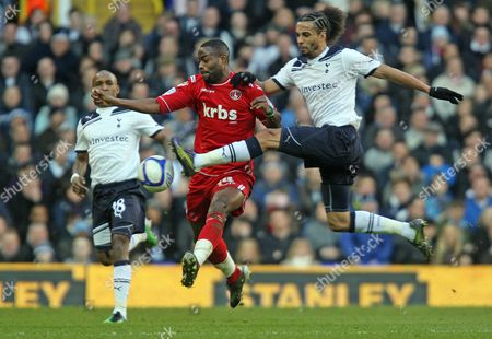 Stock Image of Benoit Assou-ekotto of Tottenham Hotspur and Akpo Sodje of Charlton Athletic United Kingdom London