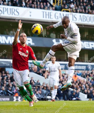 William Gallas of Tottenham Hotspur and Chico Flores of Swansea City United Kingdom London