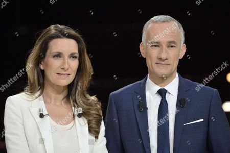TF1 TV presenters Anne-Claire Coudray and Gilles Bouleau