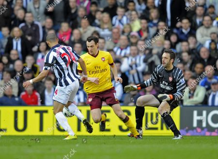 Sebastien Squillaci of Arsenal Impedes Goalkeeper Manuel Almunia Which Allows Peter Odemwingie of West Bromwich Albion to Score United Kingdom Birmingham