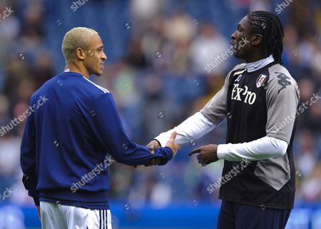 Peter Odemwingie of West Bromwich Albion and Dickson Etuhu of Fulham Shake Hands During Warm-ups United Kingdom Birmingham