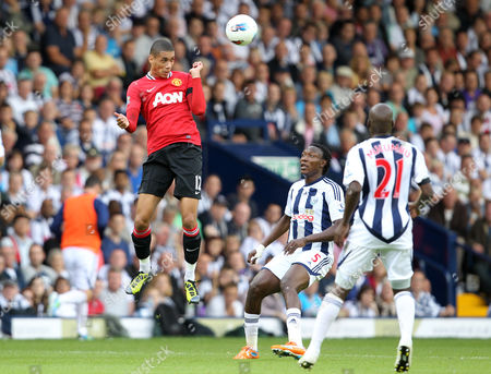 Chris Smalling of Manchester United in Action As Somen Tchoyi and Youssf Mulumbu of West Bromwich Albion Look On United Kingdom Birmingham