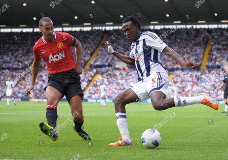 Somen Tchoyi of West Bromwich Albion Takes On Rio Ferdinand of Manchester United United Kingdom Birmingham