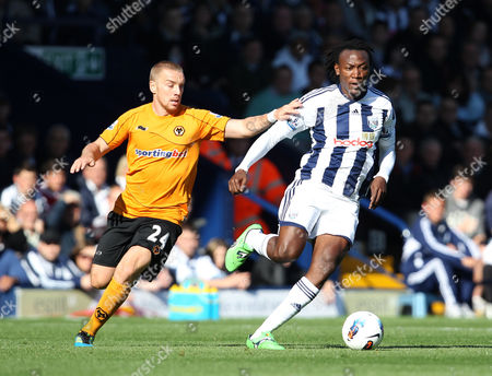 Jamie O'hara of Wolverhampton Wanderers in Action with Somen Tchoyi of West Bromwich Albion United Kingdom Birmingham