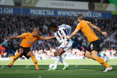 Somen Tchoyi of West Bromwich Albion in Action with Christophe Berra and Karl Henry of Wolverhampton Wanderers United Kingdom Birmingham