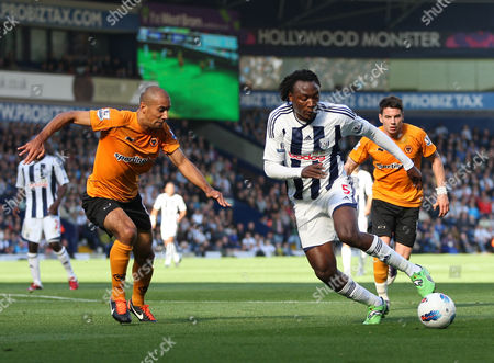 Somen Tchoyi of West Bromwich Albion Takes On Karl Henry of Wolverhampton Wanderers United Kingdom Birmingham