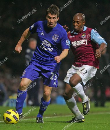 Seamus Coleman of Everton Shields the Ball From Luis Boa Morte of West Ham United United Kingdom London