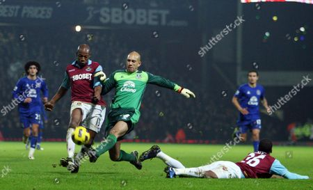 Luis Boa Morte of West Ham United is Tackled by Tim Howard of Everton United Kingdom London