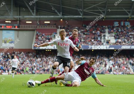 Damien Duff of Fulham in Action with Matthew Taylor and Joey O'brien of West Ham United United Kingdom London