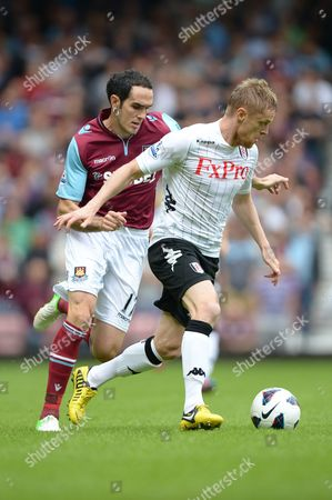 Damien Duff of Fulham in Action with Joey O'brien of West Ham United United Kingdom London