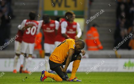 Ronald Zubar of Wolverhampton Wanderers Shows A Look of Dejection As Arsenal Celebrate Their Second Goal United Kingdom Wolverhampton