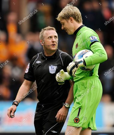 Stock Photo of Referee J Moss Talks to Wolverhampton Wanderers Goalkeeper Wayne Hennessey After He Argued with Team-mate Roger Johnson United Kingdom Wolverhampton