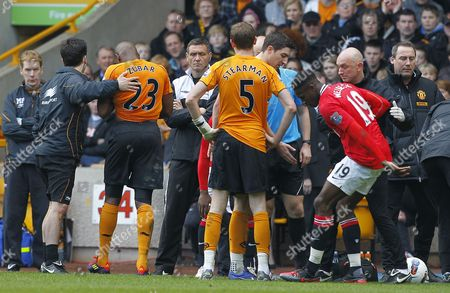 Ronald Zubar of Wolverhampton Wanderers (left) Walks Off Dejected After Being Sent Off For A Second Bookable Offence United Kingdom Wolverhampton