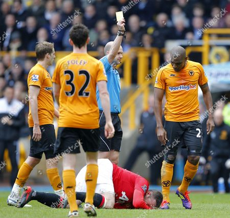 Ronald Zubar of Wolverhampton Wanderers is Shown His First Yellow Card by Referee Anthony Taylor United Kingdom Wolverhampton