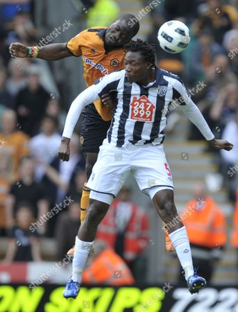George Elokobi of Wolverhampton Wanderers and Somen Tchoyi of West Bromwich Albion United Kingdom Wolverhampton