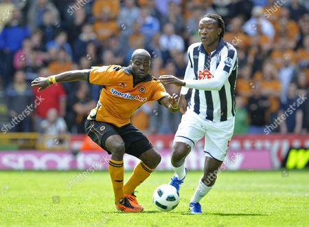 George Elokobi of Wolverhampton Wanderers and Somen Tchoyi of West Bromwich Albion United Kingdom Wolverhampton