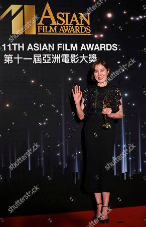 South Korea actress So-ri Moon poses after winning the Best Supporting Actress Award of the Asian Film Awards in Hong Kong