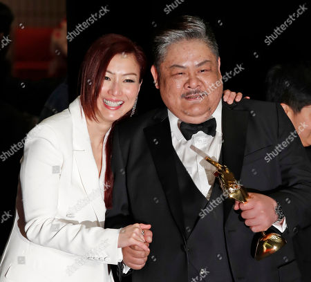 Sammi Cheng, Lam Suet Hong Kong actress Sammi Cheng, left, and actor Lam Suet pose after winning the Excellence in Asian Cinema Award and the Best Supporting Actor Award of the Asian Film Awards in Hong Kong