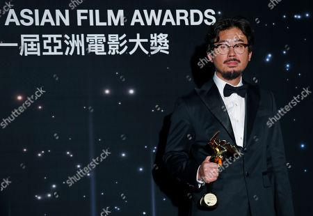 South Korea director Na Hong-jin poses after winning the Best Director Award of the Asian Film Awards in Hong Kong