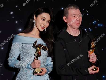 Fan Bingbing, Feng Xiaogang Chinese actress Fan Bingbing, left, and director Feng Xiaogang pose after winning the Best Actress and Best Film Awards of the Asian Film Awards in Hong Kong