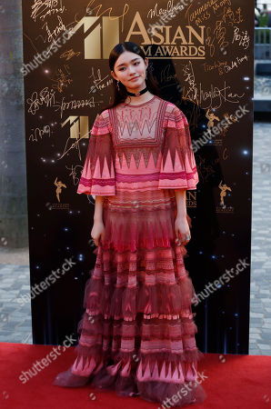 Chinese actress Yun Lin poses on the red carpet of the Asian Film Awards in Hong Kong